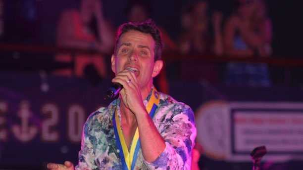 "Joe McIntyre singing ""5 Brothers and a Million Sisters"" while wearing his Boston Marathon medal on the fifth annual NKOTB cruise to the Bahamas, May 21, 2013."