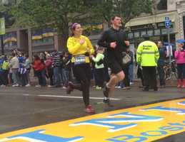 Thousands of athletes joined victims of the Boston Marathon bombings to run and walk the last mile of the race Saturday, reclaiming the triumph of crossing the finish line.