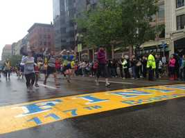 The 1-mile run began at Kenmore Square and ended at the Boston Marathon finish line.