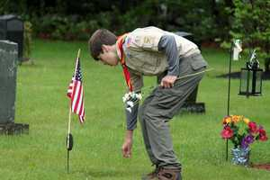 Boy Scouts decorating veterans' graves at Mount Vernon Cemetery, Boxford, Massachusetts