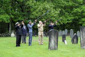 Firing a volley in tribute to veterans on Memorial Day.