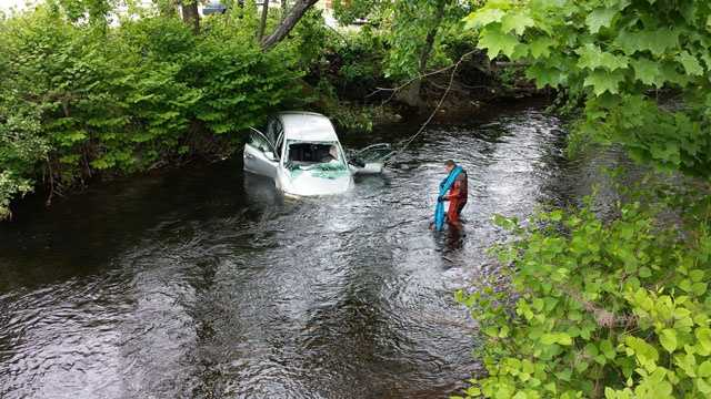 An elderly couple was pulled from a submerged car in the Nashua River in Fitchburg on May 26, 2013.