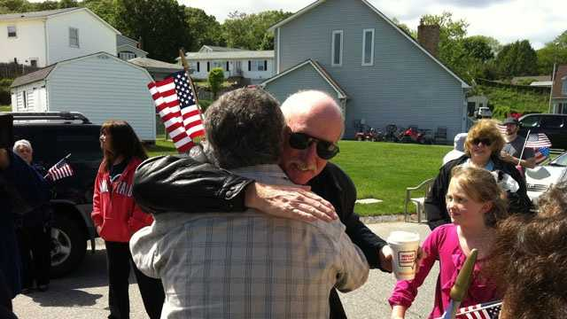 Watertown Police Sgt. Jeff Pugliese is surprised with a party for his acts of heroism on May 26, 2013.