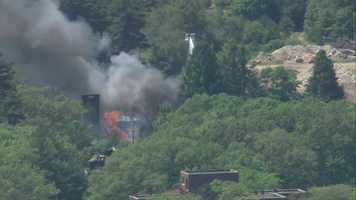 Smoke could be seen billowing from the fire for miles, officials said.