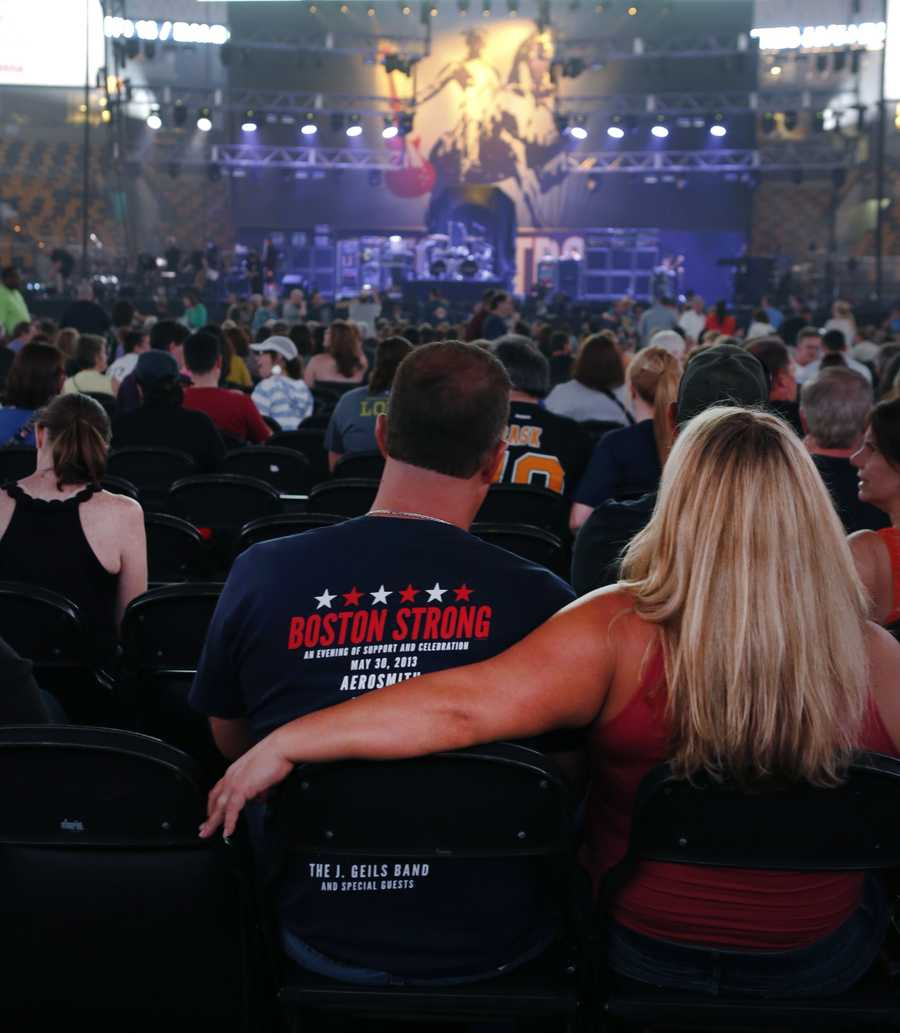 Concert goers wait for the start of the Boston Strong Concert: An Evening of Support and Celebration at the TD Garden
