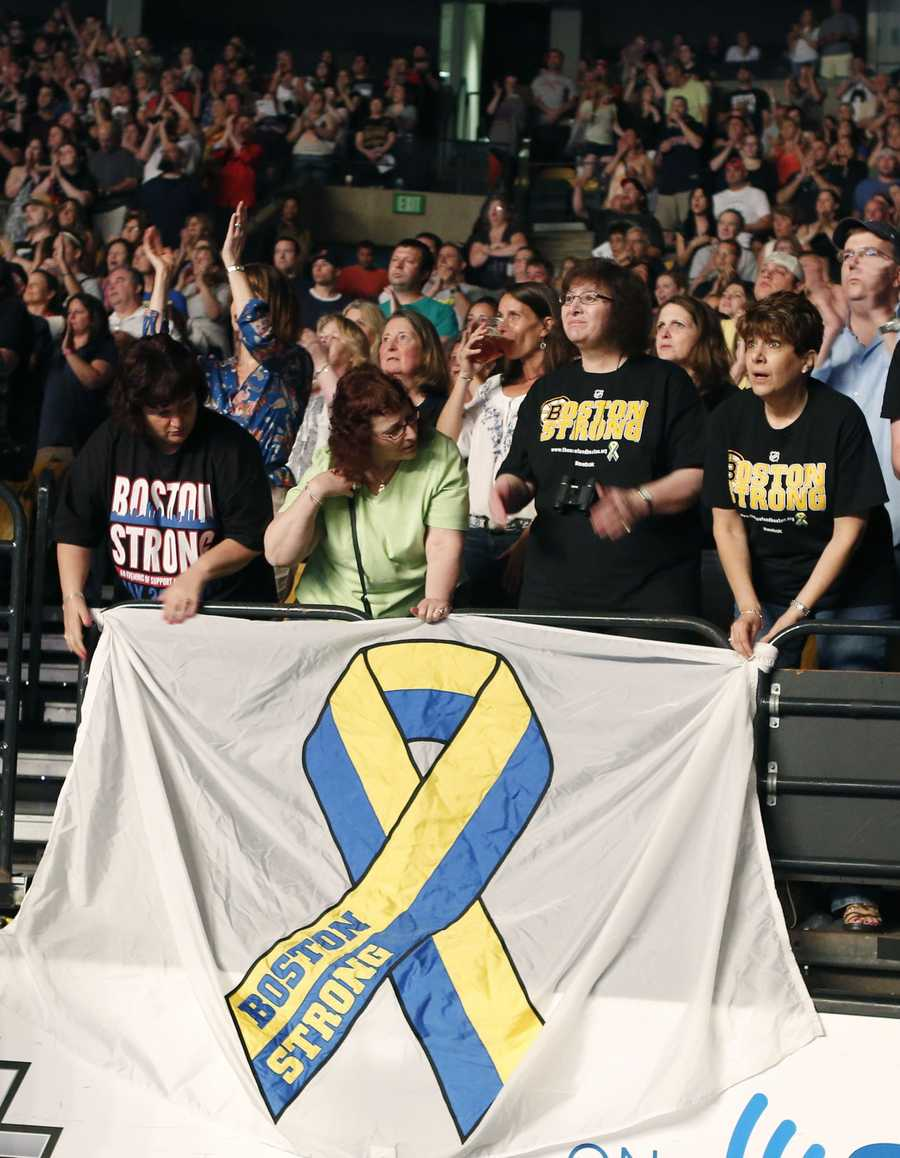 Concert goers hold a banner as they watch the Boston Strong Concert: An Evening of Support and Celebration at the TD Garden