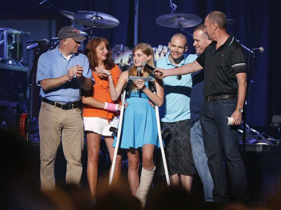 Boston Marathon bombing victim Victoria McGrath, 20, center, thanks people who help her when she was injured and help her recovery during the Boston Strong Concert: An Evening of Support and Celebration at the TD Garden