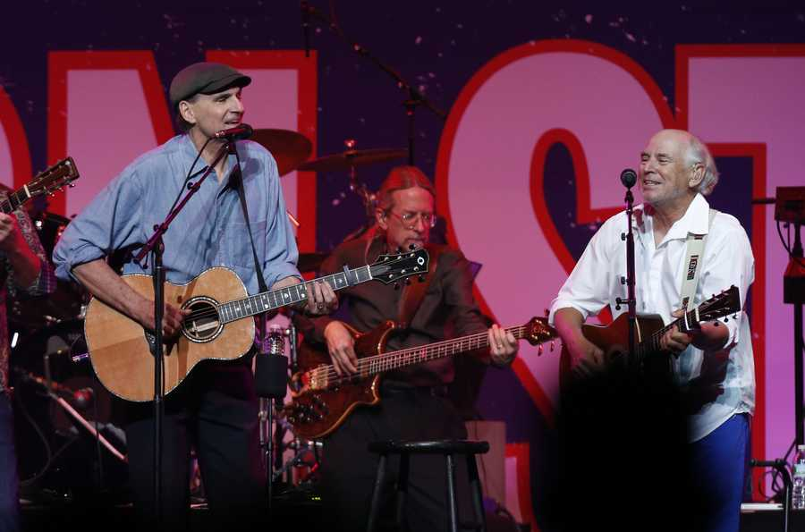 James Taylor, left, and Jimmy Buffett perform at the Boston Strong Concert: An Evening of Support and Celebration at the TD Garden.