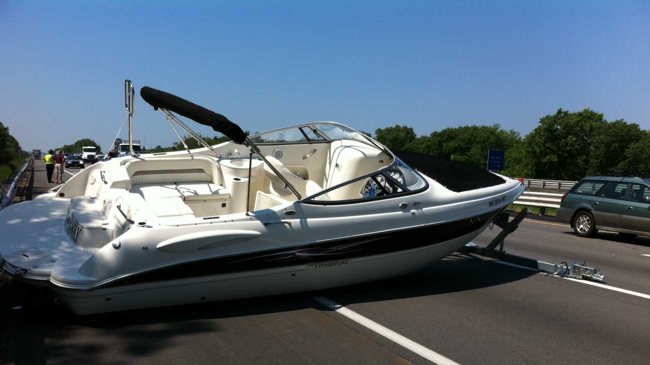 A 28-fot boat fell of its trailer and crashed on Interstate 95 north in Canton Friday morning.