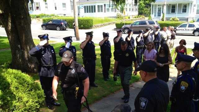 Plymouth Police officers salute K9 dog Kaiser before he was euthanized on Friday, May 31, 2013.