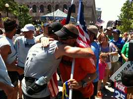 Frank Fumich (left) and Matt Nelson (right) hug after arriving in Boston.