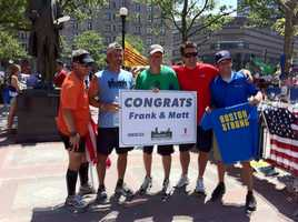 Matt Nelson (orange) and Frank Fumich (light blue) stand with supporters after arriving near the Boston Marathon finish line on Saturday, June 1, 2013.