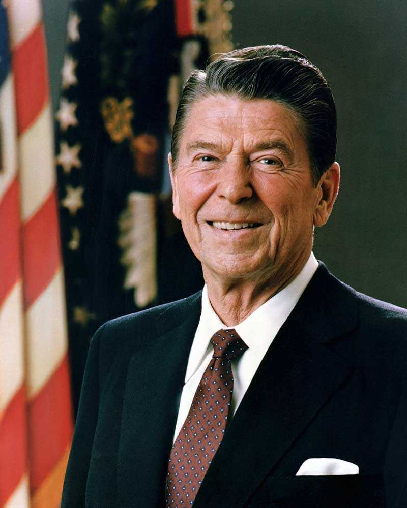 "2004: Ronald Reagan, the 40th president of the United States from 1981–89, dies at the age of 93 in Bel Air, California, of pneumonia, brought on by Alzheimer's disease. Reagan, who rose to fame as a radio, television and film actor before entering politics, also served as the governor of California between 1967 and 1975. Some of his most notable films include 1940's ""Knute Rockne, All American,"" 1942's ""Kings Row"" and 1951's ""Bedtime for Bonzo."" As a president, Reagan became known for sweeping new political and economic initiatives, such as reducing tax rates to spur economic growth, deregulating the economy and reducing government spending. His time in office also saw the end of the Cold War, the beginning of the War on Drugs, and the revelation of the Iran-Contra affair."