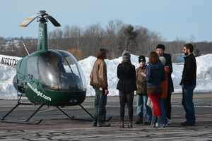 Jake's friends gather to watch him in his first solo flight