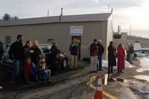 Friends and family gather to watch Jake in his first solo flight