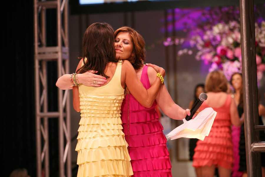 Liz Brunner hugs Kelley Tuthill