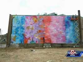 ...created this 30'x70' abstract painting.