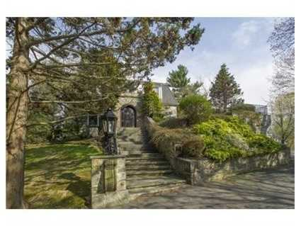 Hidden gardens with wooded views surround this unique property.