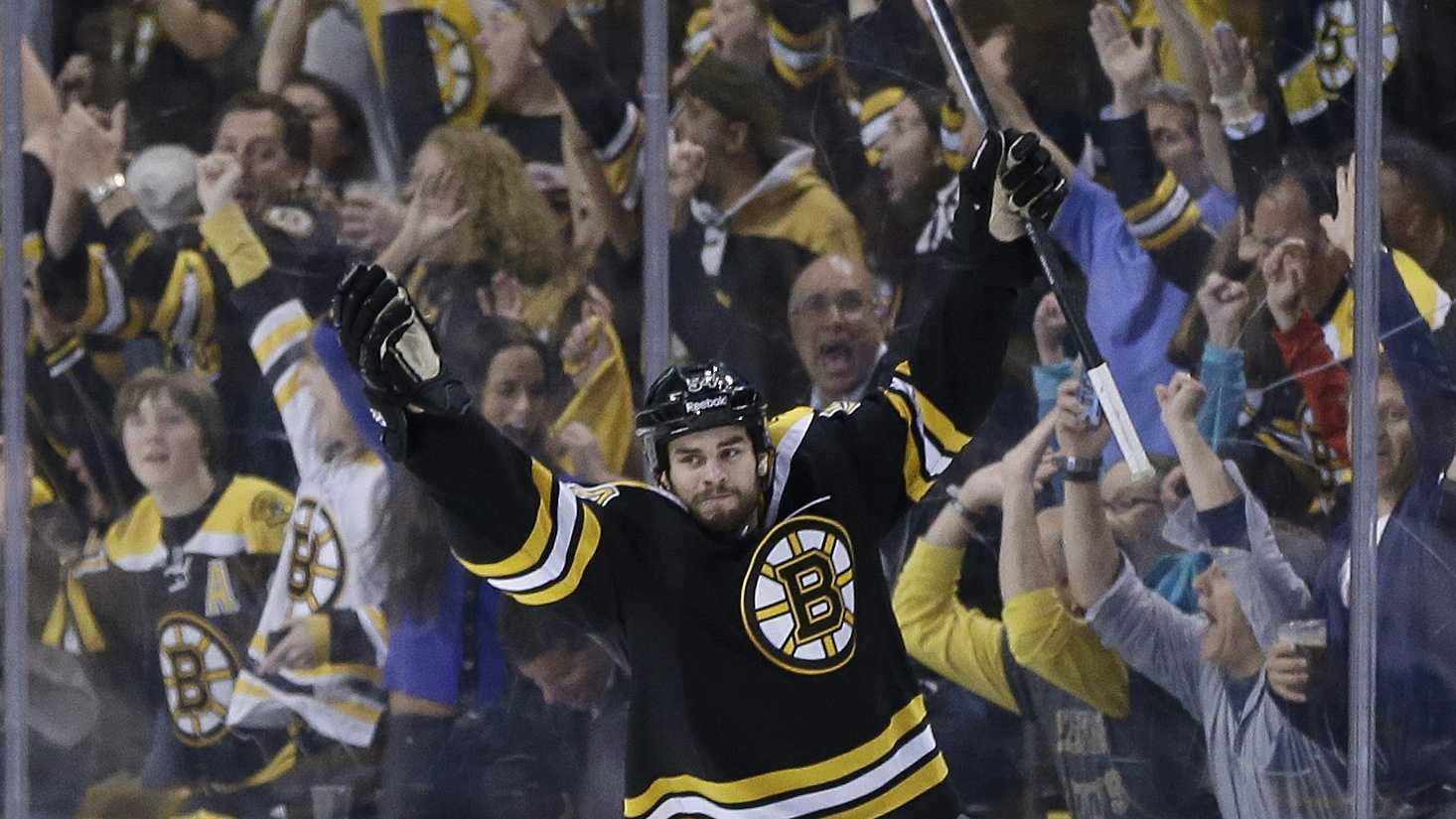 Boston Bruins defenseman Adam McQuaid  celebrates his goal against the Pittsburgh Penguins during the third period of Game 4 in the Eastern Conference finals of the NHL hockey Stanley Cup playoffs, in Boston on Friday, June 7, 2013.