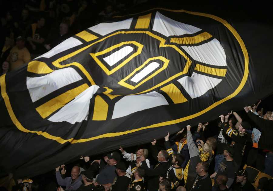 Fans pass a large Boston Bruins banner around the arena prior to Game 4 in the Eastern Conference finals of the NHL hockey Stanley Cup playoffs between the Bruins and the Pittsburgh Penguins, in Boston on Friday, June 7, 2013.