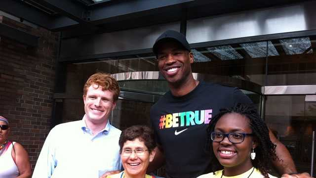 NBA star Jason Collins poses with former college roommate and Rep. Joe Kennedy before Boston's Pride Parade on Saturday, June 8, 2013.