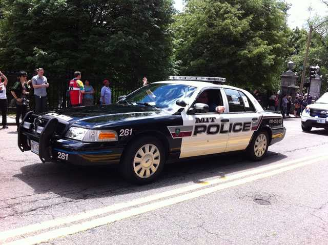 An MIT police cruiser rides in the parade in memory of Officer Sean Collier, who was killed by one of the Boston Marathon bombers.