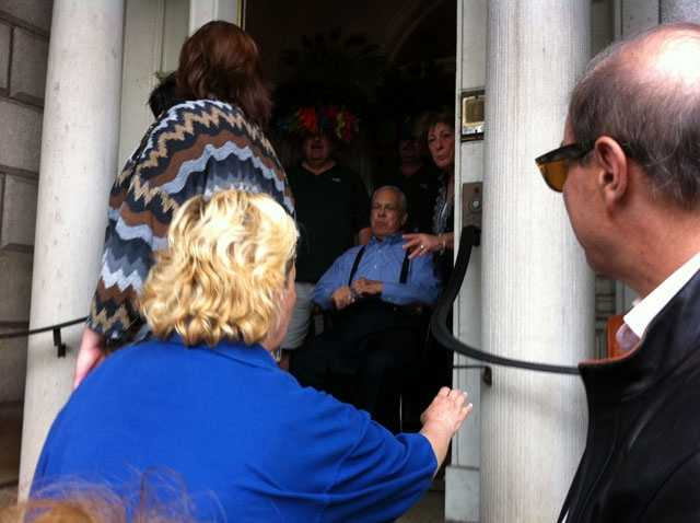 Parade participants greet Menino on the front steps of the Parkman House.