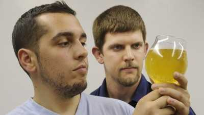 Jeremy Quaglia, left and Kyle Schmitt inspect their product.