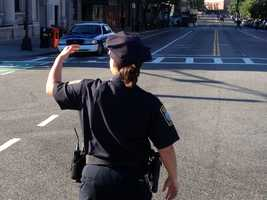 Police directing traffic at Massachusetts Avenue and Boylston Street.