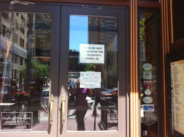 Businesses like Max Brenners Restaurant had signs in their windows telling customers they would be open later in the day.