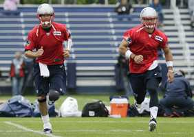 Tim Tebow practiced with veteran New England starter Tom Brady and backup Ryan Mallett at the start of the three-day Patriots minicamp that runs through Thursday.