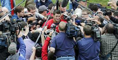 Dozens of cameras and extra reporters flooded what is a routine off-season New England Patriots workout.