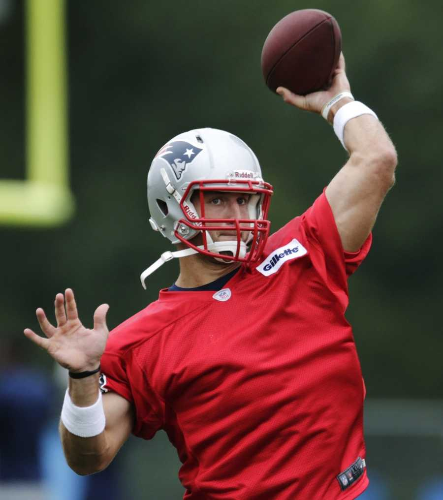 New England Patriots quarterback Tim Tebow throws during a NFL football practice in Foxborough, Mass., Tuesday June 11, 2013.
