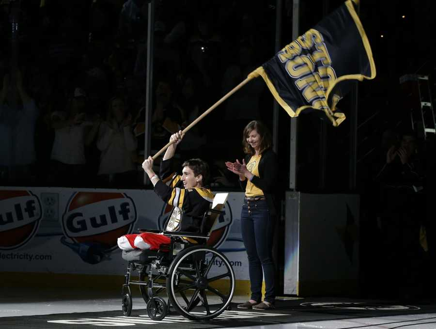 Boston Marathon bombing victim Jeff Bauman waves a Boston strong flag before game two of the first round of the 2013 Stanley Cup playoffs against the Toronto Maple Leafs at TD Garden on May 4, 2013.