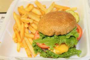 Obama ordered a Cheeseburger with lettuce, tomato, mustard and French Fries.