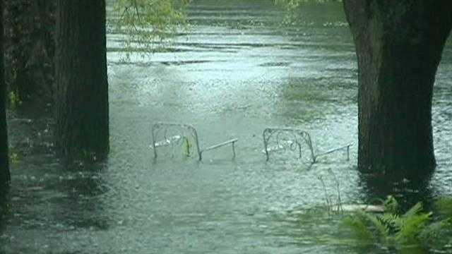 A flood warning has been issued for parts of MetroWest as a nor'easter moves up the coast packing heavy rain and high winds.