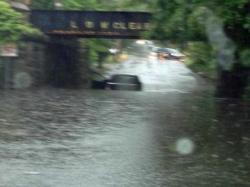 This driver had to bail after getting caught in rising waters on Pleasant Street in Billerica.