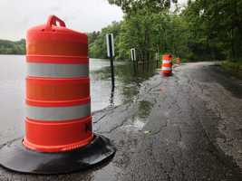 On Pelham Island Road in Sudbury, water overflowing from Heard Pond.