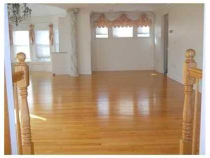 The home has gleaming hardwood floors.