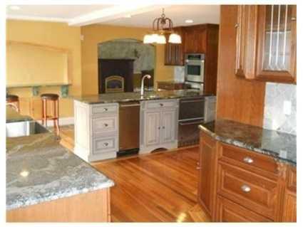 It has hardwood, granite and cherry cabinets.