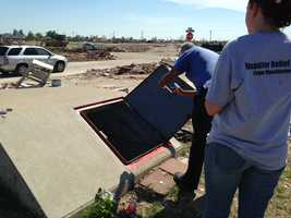 The volunteers split into two groups -- one helped rebuild in Moore, Okla. and the other traveled to Shawnee, Okla.