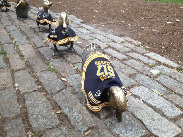 Famous statues in Boston are showing their support for the Bruins during the Stanley Cup finals against the Chicago Blackhawks.