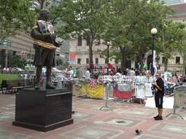The statue is located next to the memorial for the victims of the Boston Marathon bombings.