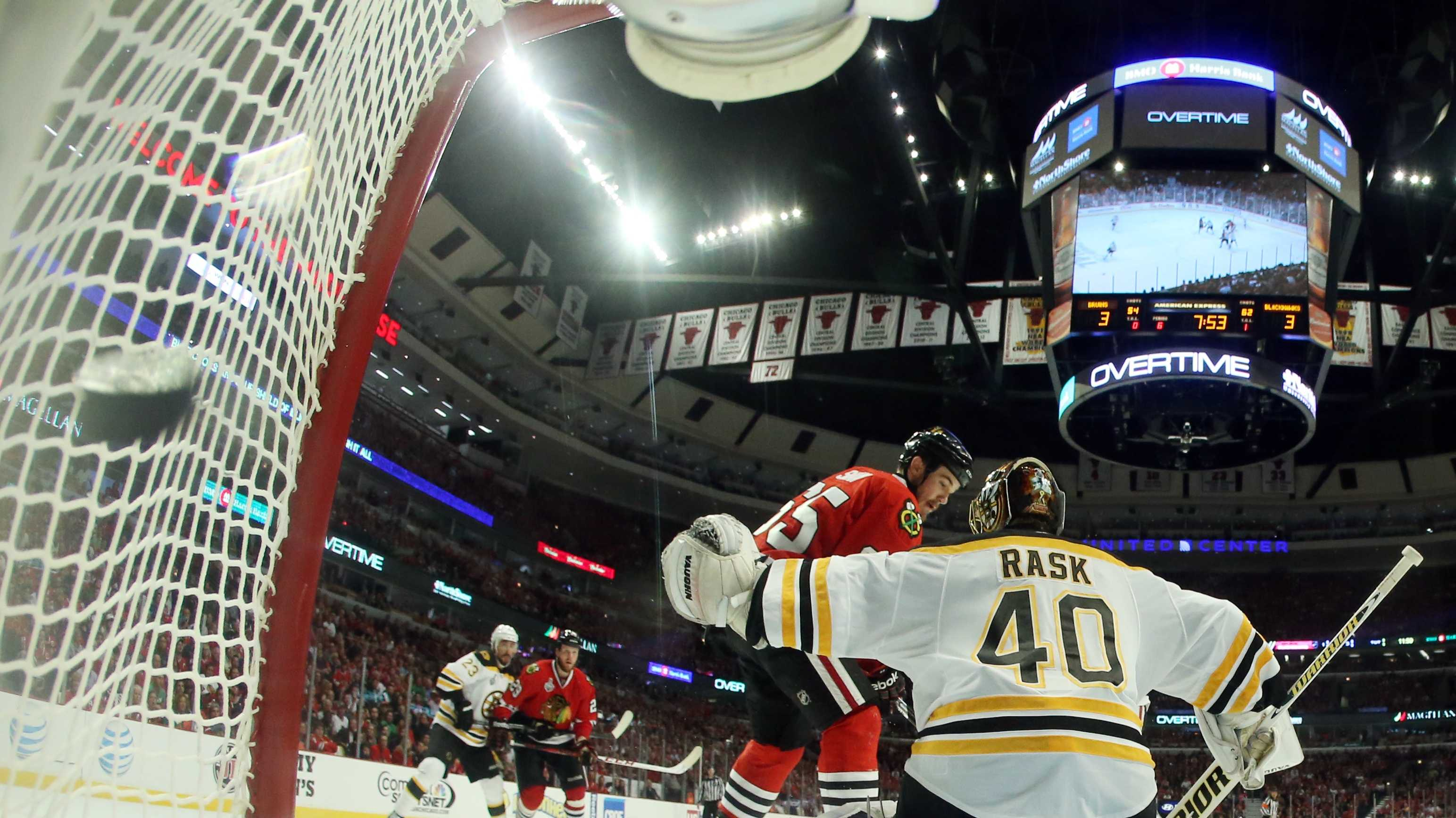 The puck flies into the net as Chicago Blackhawks center Andrew Shaw (65) scores the game winning goal against Boston Bruins goalie Tuukka Rask (40) during the third overtime period of Game 1 in their NHL Stanley Cup Final hockey series, Wednesday, June 12, 2013, in Chicago. The Blackhawks won 4-3
