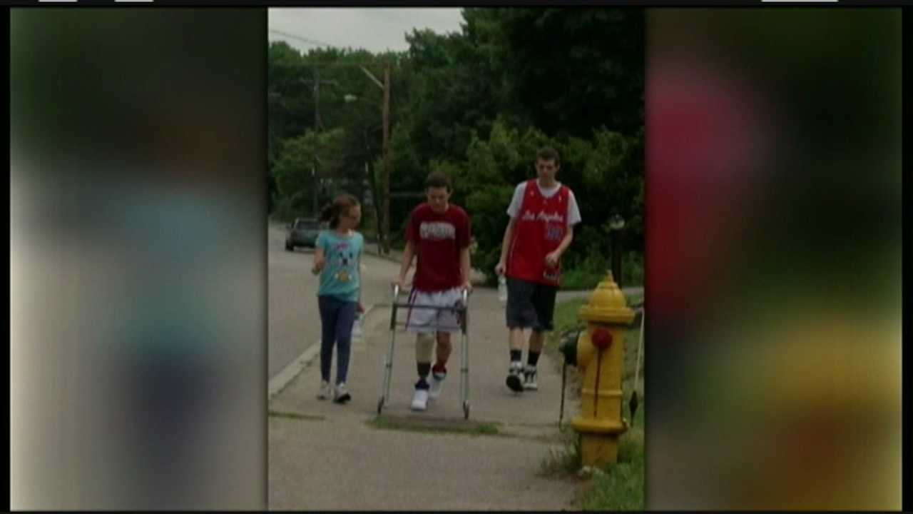 A young lacrosse player is back on the field after losing part of his led in a crash.