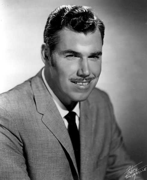 Country singer Slim Whitman's career began in the late 1940s, and his tenor falsetto and ebony mustache and sideburns became global trademarks. (January 20, 1923  – June 19, 2013)