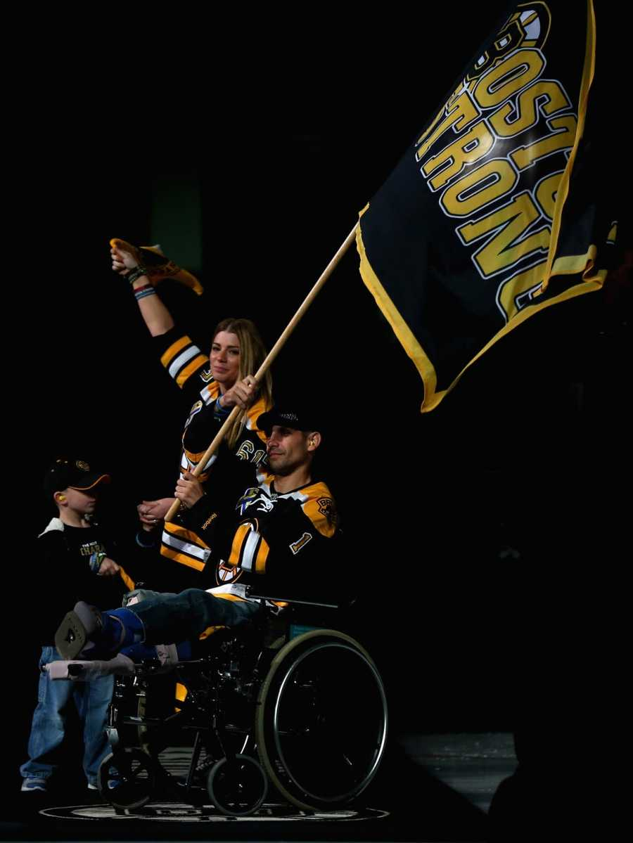 Marc Fucarile, who was injured in the Boston Marathon bombings, holds a 'Boston Strong' flag prior to Game Four of the 2013 NHL Stanley Cup Final between the Chicago Blackhawks and the Boston Bruins at TD Garden on June 19, 2013 in Boston, Massachusetts.
