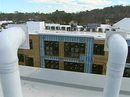 Reflective white roofs are said to reduce the building's heat penetration.