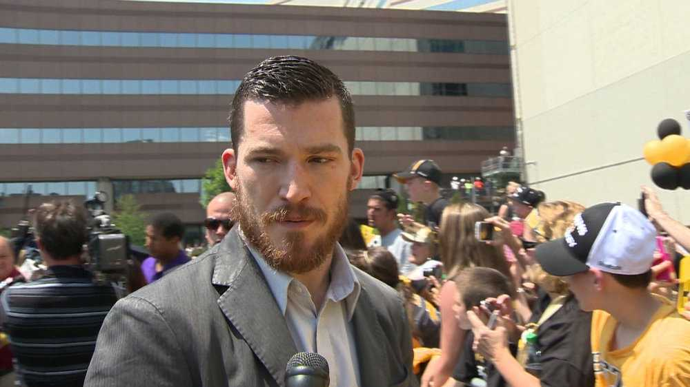 Andrew Ference speaks with members of the media.