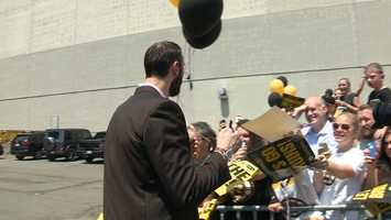 Zdeno Chara takes some time to greet fans cheering on the team.